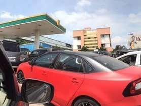 Skoda Rapid CNG Spied At Gas Station In India