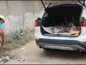 Frustrated BMW X1 Owner Uses His Luxury SUV to Collect Garbage