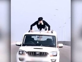 Driver Climbs Up On Mahindra Scorpio's Roof To Do Push-Ups, Arrested