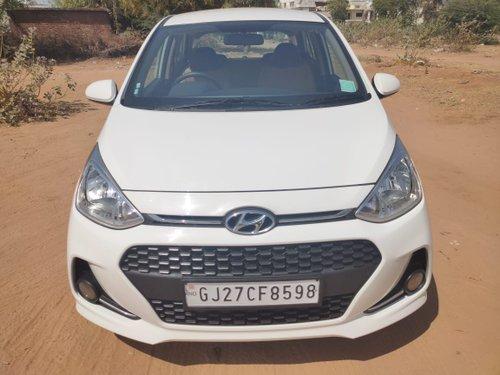 2018 Hyundai Grand i10 Petrol AT for sale in Ahmedabad
